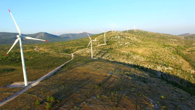 Aerial view of windmills with rotating blades on a sunny day video