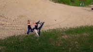 Aerial view of Wing Chun  on a coast between strong men video