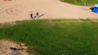 Aerial view of Wing Chun  on a sand between  strong men video