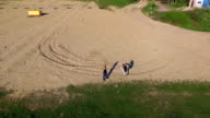 Aerial view of Wing Chun  on a sand between two strong men video