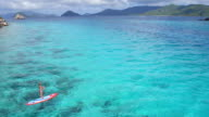 aerial view of woman exploring the Caribbean on paddleboard video