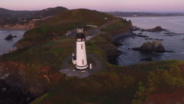 Aerial view of Yaquina Bay Lighthouse at sunset video