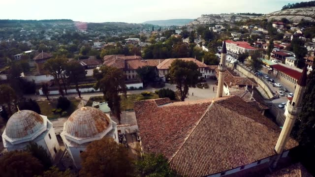Aerial view on the old city with church before sunset, sunrise. Fog, Cloudy sky. Bahchisarai, Crimea, Russia. video