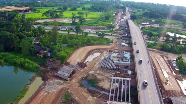 Aerial view over bridge construction site building video