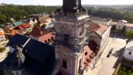 Aerial view over cathedral on countryside in mountains at sunset video