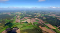 Aerial view over fields and pasture patchwork farmland in Lower Saxony, Germany video