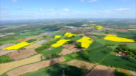 Aerial view over green pasture patchwork farmland in Lower Saxony, Germany video
