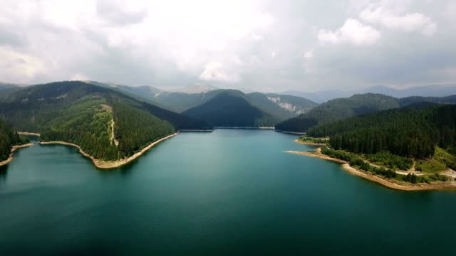 Aerial view over lake and mountains video