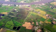 Aerial view over land and river in Bangkok, Thailand video