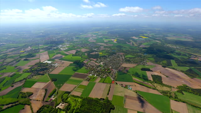 Aerial view over pasture patchwork farmland in Lower Saxony, Germany video