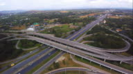Aerial view over Traffic on highway intersection. video