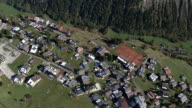 Aerial view over village and meadow video
