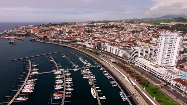 Aerial view Ponta Delgada from marina, Sao Miguel, Azores, Portugal. Yachts along the port piers video