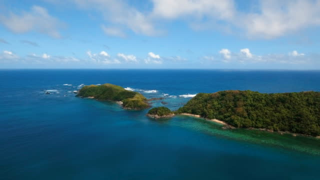 Aerial view Seascape with tropical island, beach, rocks and waves. Catanduanes, Philippines video
