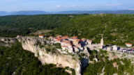 Aerial view: Seaside village on the edge of a cliff. Destination scenic on Cres video