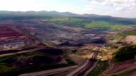 Aerial view shot for Mining dump trucks working in Lignite coalmine lampang thailand video