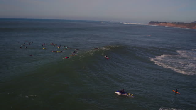 Aerial View Surfers Riding Big Waves at Mavericks video