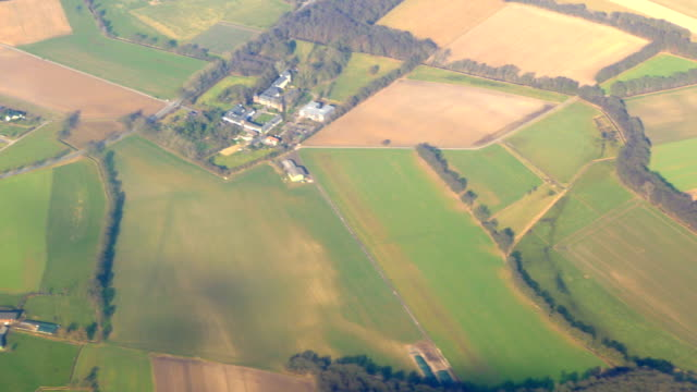 Aerial view to the green fields and small town video