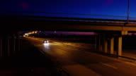 Aerial view. Traffic at illuminated highway interchange. Evening traffic. video
