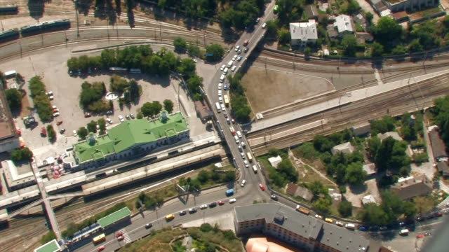 Aerial View train station and motorway traffic. video