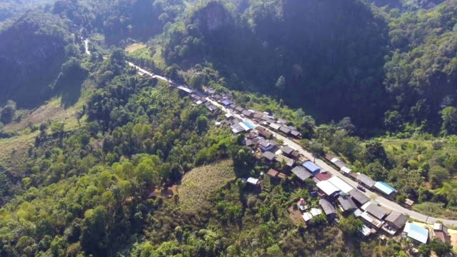 Aerial view : Tranquil small tribe village on the mountain with morning sunlight video