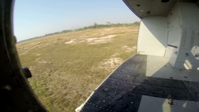 aerial view tropical sky and ground from helicopter passenger cabin landing flight video