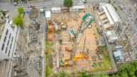 aerial view :  two crane truck are in a electrical site video