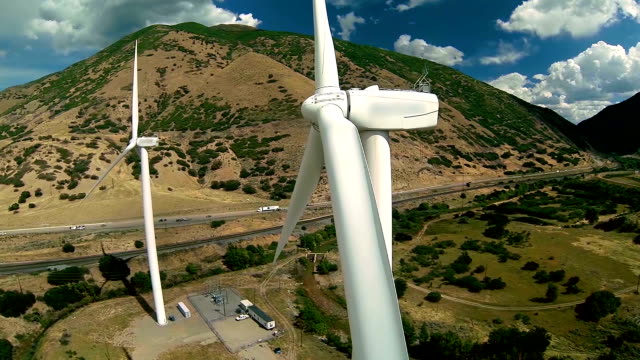 Aerial view wind turbines moving and passing by closely video
