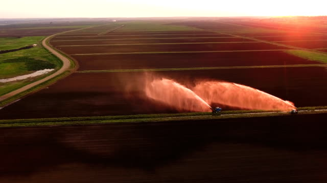 Aerial view:Irrigation system watering a farm field video