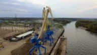 Aerial view:River port with cranes and ships video
