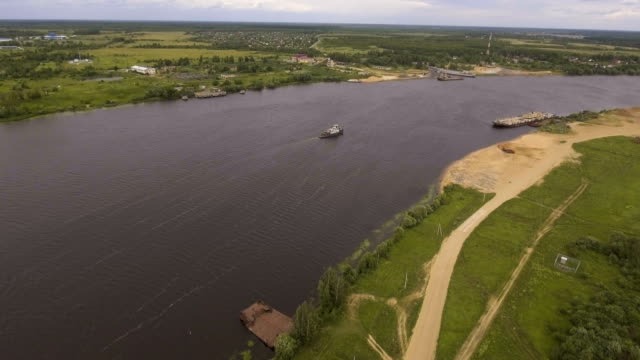 Aerial view:Tugboat on the river video