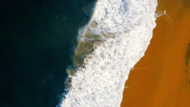 Aerial waves breaking on beach video