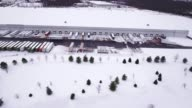 Aerial wide shot of warehouse snow video