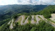 Aerial wide shot of whole serpentine downhill road track video
