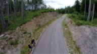 Aerial wide shot of wide asphalt road and longboarder riding video