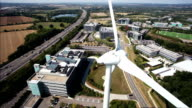 Aerial wind turbine by busy highway video