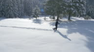 Aerial - Young man winter hiking video