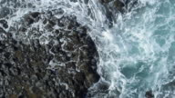 Aerial Zoom Out Shot Of Waves Breaking On Rocky Shore video