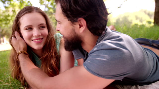 Affectionate guy lovingly touching his girlfriend's face video