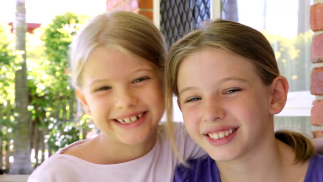 Affectionate Sisters little girls giving a hug video