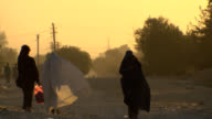 Afghanistan road, Afghan woman with burkha. video
