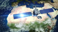 Africa. Telecommunication satellite orbiting Earth. video