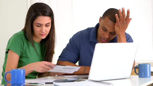 African american and caucasian couple in debt video