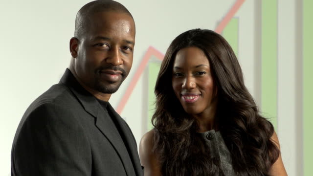 African American business man and woman smiling video