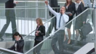 DS African American business man doing happy dance on stairs video