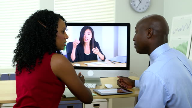 African American business team holding video chat video