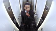 POV Afro American businessman in the elevator video