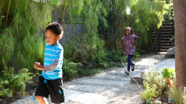 African American Children Running Through the House Yard video