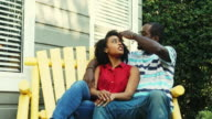 African American Couple Enjoying Time Together Sitting Outdoors video