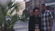 African American couple in the city smiling at the camera and making funny faces video